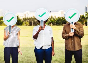 Types of SEO represented by 3 people holding signs