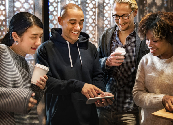 man sharing content on his smartphone with friends